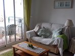 Comfortable sitting room that leads straight onto the terrace with Air conditioning.