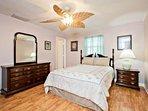 Master bedroom features queen size bed, ceiling fan...