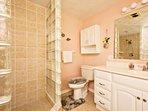 Master bathroom has walk-in-shower with hand held shower head.