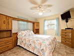 Guest bedroom features queen size bed, ceiling fan and 32 inch flat screen cable television.
