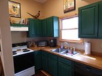 Kitchen With Full Size Range, Dishwasher, Toaster Oven, Coffee Maker, Microwave, and Fridge