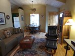 Living/Dining Area With Several Antiques