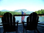 Boathouse Rooftop Deck With Adirondack Chairs, Lounge Chairs, Fire Pit, and Dining Table