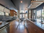 This kitchen is a chef's dream! Plus, you can see all the way to the pool!