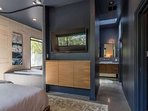 You'll love the unique, open design of this master suite - and the TV as well!