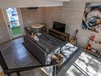This living space has all you need! Put on the TV or soak in the rays outside on the patio!
