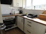 Kitchen showing induction hob and cooker