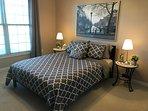 European style bedroom with queen bed.