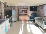 Comined kitchen and dining area featuring a country style oven and gas cooktop. Foxtel and Netflix.