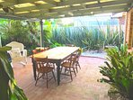 Cook a bbq and eat in the tranquil tropical garden setting.