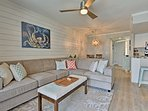 The condo is decorated with soothing colors and elegant beach decor.