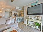 Lounge on the plush couch and watch the flat-screen cable TV.