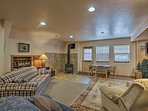 Get cozy next to the wood-burning stove and watch a movie on the flat-screen TV.