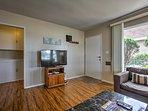 Hardwood floors, comfortable furnishings, and an abundance of natural light highlight this home!