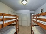 Two traditional twin-over-twin bunk beds complete this room.