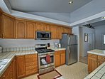 The fully equipped kitchen features sleek stainless steel appliances.