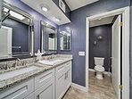 Clean up in this bathroom offering a walk-in shower.