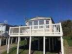 Front View of Ocean Blues Retreat - decking surrounding caravan enabling you Enjoy views & sun ?