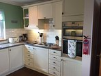 Fully equipped kitchen and open plan dining room with loch views