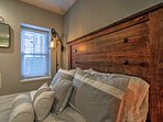 This room is adorned with a rustic headboard.