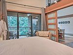 Shoji screen doors separate this bedroom from the living room.