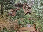 This vacation rental cottage has 2 bedrooms and 2 bathrooms in a forest setting.