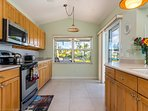 bright , open kitchen opens to pool area and covered awning patio