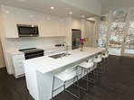 Fully equipped kitchen with island stools