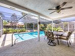 Huge screened in lanai with pool and outdoor dining