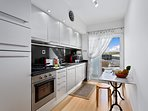 The kitchen is very well equipped and has a handy balcony with drying rail.