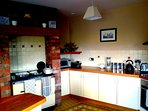 Large fully equipped kitchen with Stanley stove