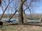 Hammocks by the river to enjoy the view.