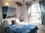 Modern queen bed with oceanview
