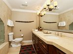 The spacious master bath offers a double vanity, steam shower and jacuzzi tub providing lots of space and comfort