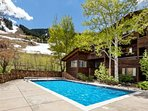 The outdoor pool is open in the summer.  The chaise lounge chairs are an ideal place to enjoy views of Aspen Mountain...