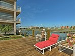 The condo's deck is perfect for a comfortable afternoon enjoying the sun.