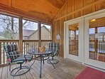 As you relax on the screened-in porch, you'll have unobstructed lake views.