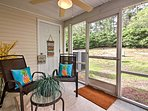 The screened-in porch is a great place to spend time with loved ones.