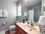 Rinse off the day in this convenient en-suite bathroom.