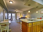 The kitchen flows seamlessly into the living room.