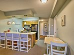 Dine at either the 4-person breakfast bar or 2-person table.