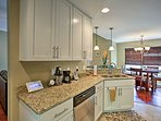 Enjoy the granite countertops and spotless white cabinetry.