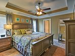 Unwind on the cozy king bed in the master bedroom.
