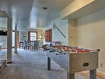 Play a game of foosball downstairs.