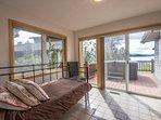Sunroom with twin and lake views