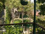The veranda overlooking the gardens attached to this vacation home in Kasauli