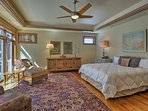 A plush king bed highlights the master bedroom.