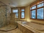 This bath is complete with a jacuzzi tub, walk-in shower, and heated floors.