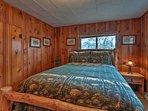 Pine-paneled walls line this queen bedroom.