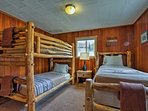 Twin-over-twin bunk beds sit next to a separate twin bed.